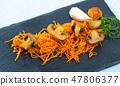 Slate of freshly fried mushrooms with carrot 47806377
