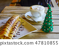 A cup of coffee with pancake 47810855