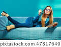 tablet, woman, couch 47817640