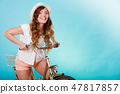 Active woman riding bike bicycle. Recreation. 47817857