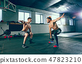Athletic man doing exercise for arms. 47823210