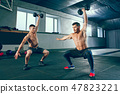 Athletic man doing exercise for arms. 47823221