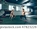 Athletic man doing exercise for arms. 47823226