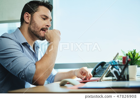 Anxious Businessman Biting Nails Working With Laptop Computer In Office 47826908
