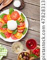 Caprese salad with rose and white wine 47828313