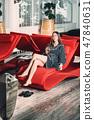 Beautiful woman relaxing in bathrobe in spa center 47840631