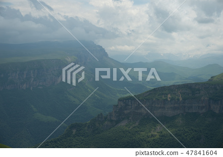 Dramatic landscape of a green valley at the foot of the Inal Plateau in the North Caucasus 47841604