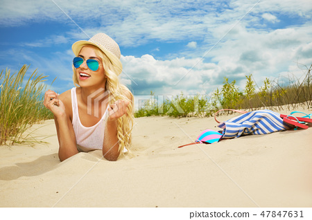 long blonde haired girl in bikini on  beach 47847631