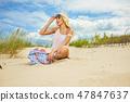 long blonde haired girl in bikini on  beach 47847637