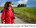 Female hiking woman happy and smiling during hike trek on Toscan 47847920