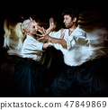 Aikido bodokas man and woman isolated black background 47849869