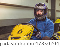 Men driving kart car with speed in a playground racing track. 47850204