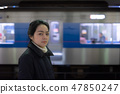 Asian woman in station 47850247
