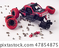 Disassembled car and scattered parts. Broken toy 47854875