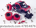 Disassembled car and scattered parts. Broken toy 47854876