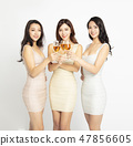 female Friends Make Toast and Celebrate At Party 47856605