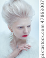 beautiful albino young woman with red lips 47863007