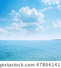 blue sea and low clouds over it 47864141