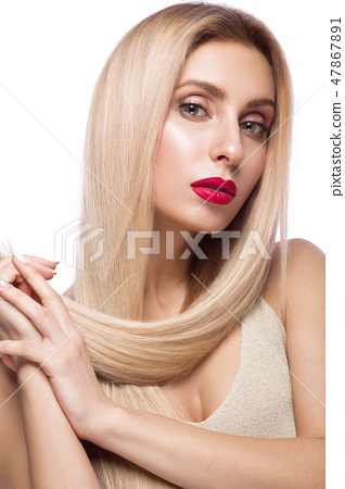 Beautiful blond girl with a perfectly smooth hair, and classic make-up. Beauty face. 47867891