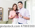 Smiling young couple toasting wineglasses 47869360