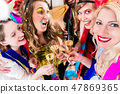 People on party drinking champagne 47869365