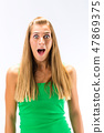 Excited young woman in green tanktop 47869375