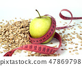 green apple, tailor meter and oatmeal 47869798