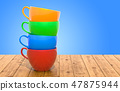 Stack of colorful cups on the wooden table 47875944