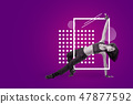 A young attractive female dancer doing a downrock dance move on a purple background with white 47877592