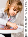 Small girl with coloring book and pencils 47878607