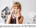 Female toddler looking out of wooden photocamera 47878609