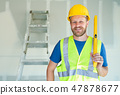 Male Contractor in Hard Hat Safety Vest and Level  47878677