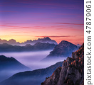 Mountains in fog at beautiful sunset in autumn  47879061