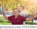 Mixed Race Hispanic Caucasian Son and Dad Playing 47879084