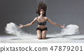 ballet dancer jumping with flour 47879201