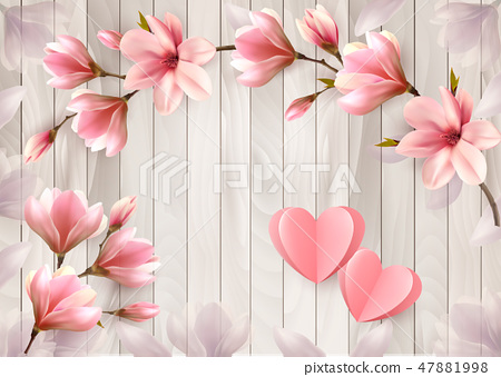 Pink flowers and paper hearts on a wooden sign.  47881998