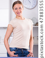 Woman standing with hand in pocket 47883555