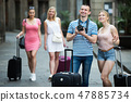 Young couple tourists holding camera in hands 47885734