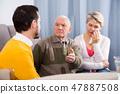 Grandfather teaches grandson 47887508