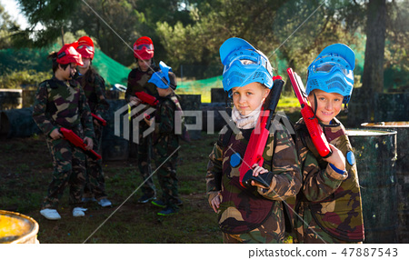 Two kids paintball players 47887543