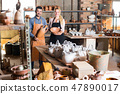 Two glad craftsmen with ceramic 47890017
