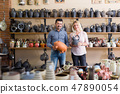 Couple buying pottery dish-ware 47890054