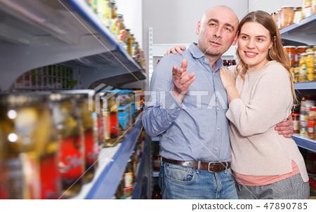 Man and woman choosing pickles goods 47890785