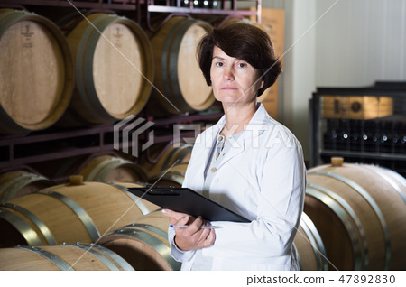 Expert examines equipment at winery 47892830