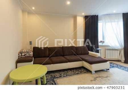 Living room interior with large sofa 47903231
