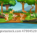 Cartoon happy wild animals in a pond scene 47904520