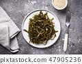 Seaweed salad with sesame seeds 47905236