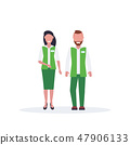 couple man woman supermarket employees standing together salesman and saleswoman in green uniform 47906133