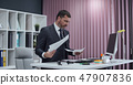 Businessman working in office, standing work at computer. 47907836