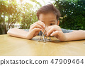 Young boy play a  stick and magnetic ball 47909464